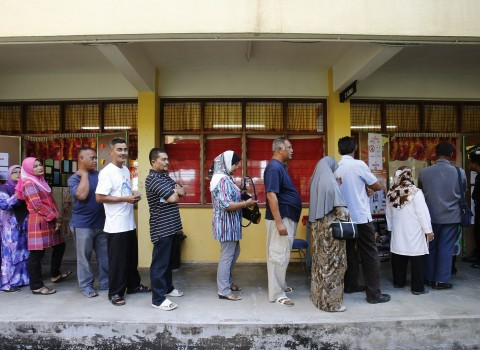 Voters queue up to cast their ballots during the general elections in Pekan