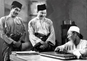 """Kuala Lumpur 06 May 2014. Labu (M. Zain) and Labi (P. Ramlee) with a kadi (Aziz Sattar) in the movie """"Nasib Si-Labu Labi,pada tahun 1968.Recopy"""